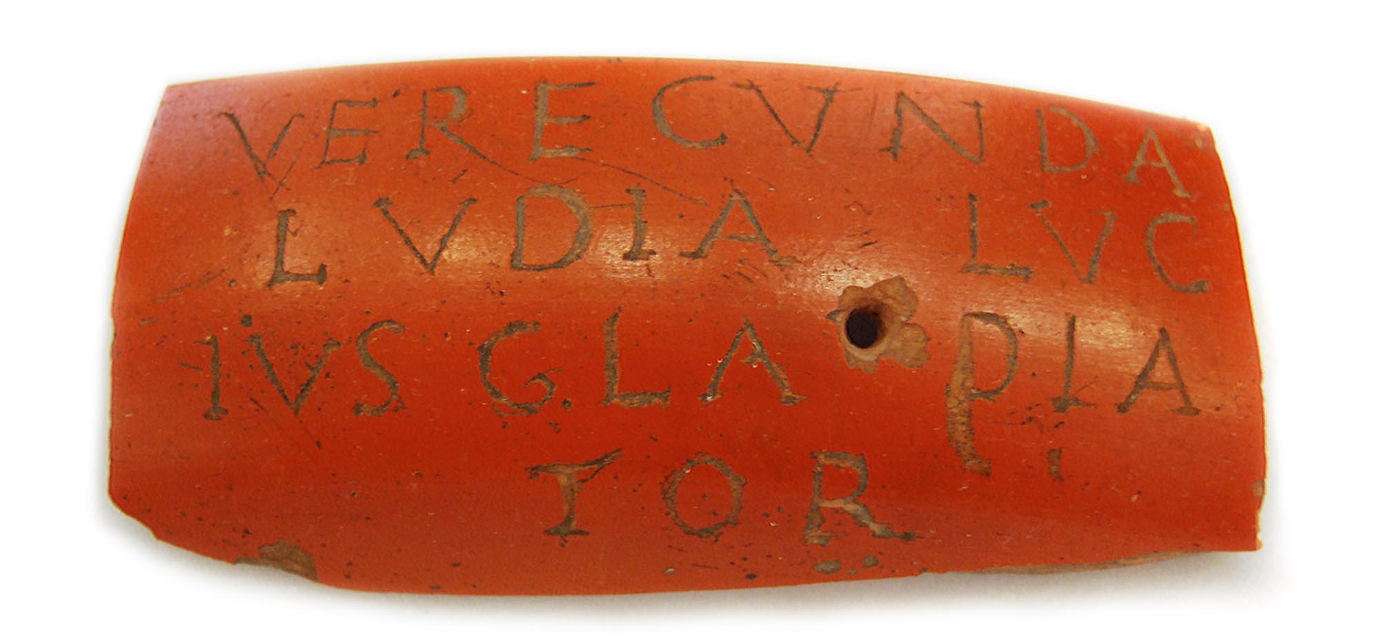 A sherd of red-slip Roman pottery with the inscription VERECVNDA LVDIA LVCIVS GLADIATOR meaning 'Verecunda the actress (or female gladiator) and Lucius the Gladiator'. Possibly a love token meant to be worn -