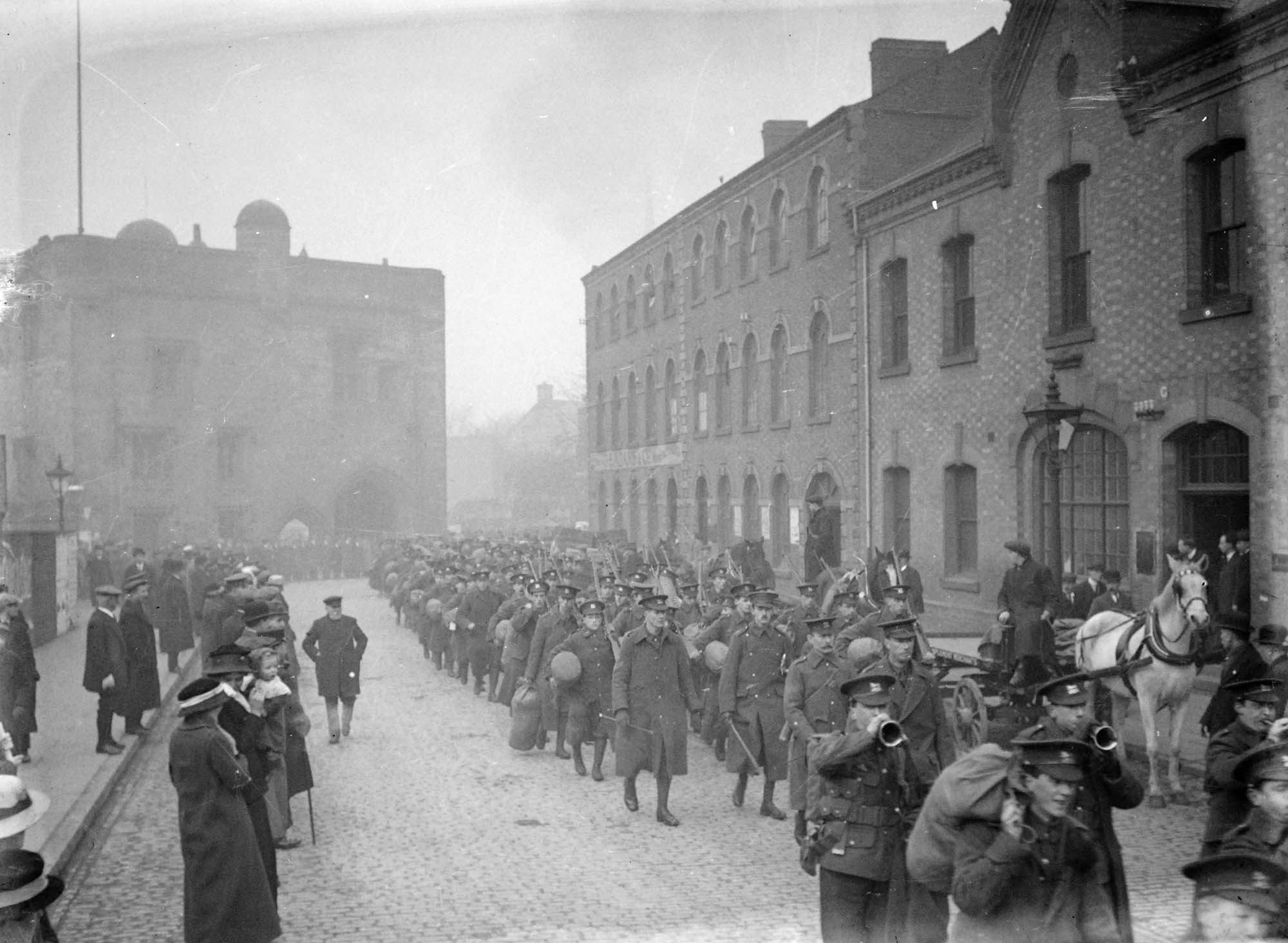 Fully accoutred troops of Leicestershire Regiment marching down Newarke Street, 1914 -
