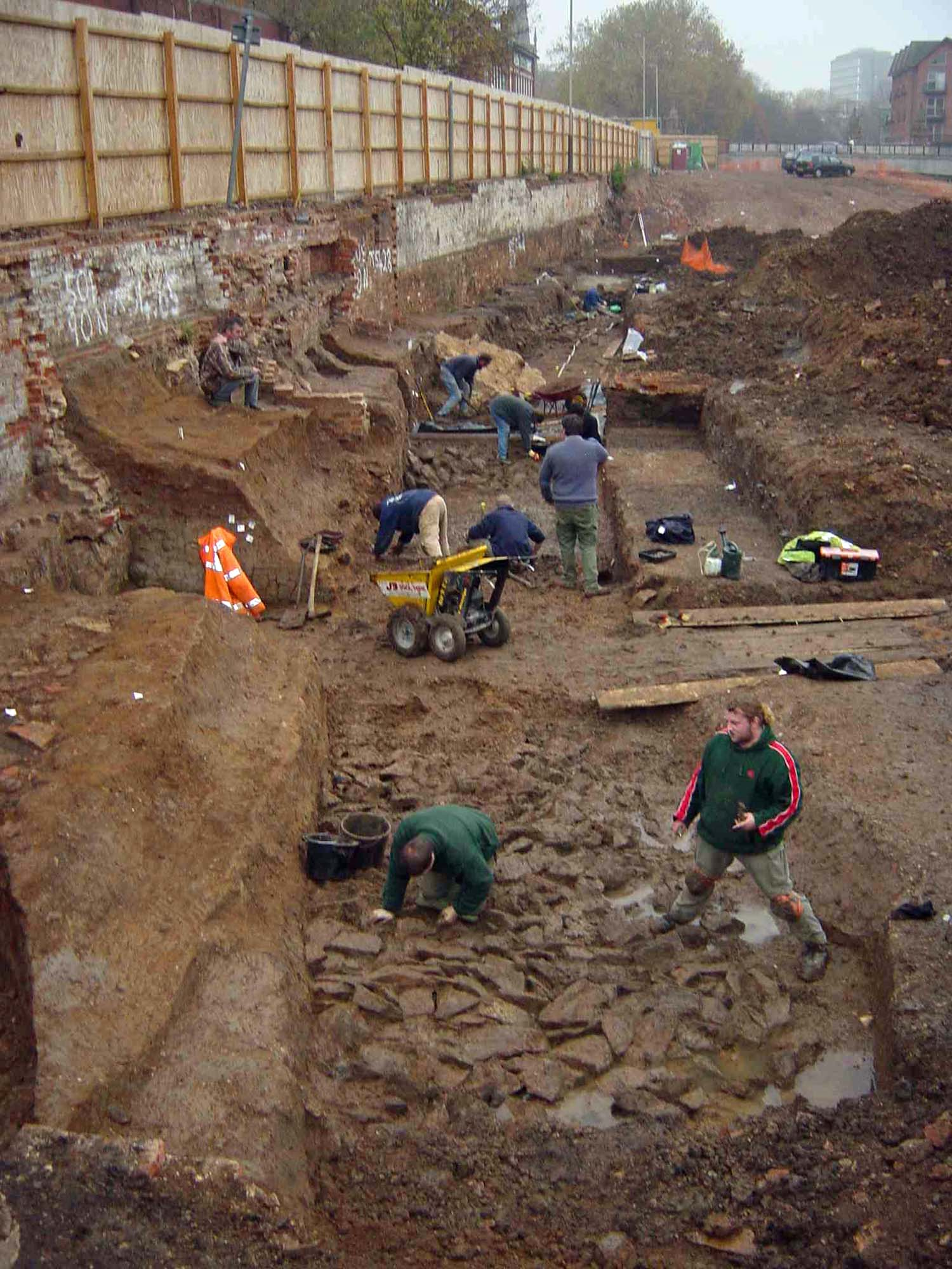 Archaeologists excavate a length of the medieval town defences on Bath Lane. Fallen masonry next to the wall and areas of scorched foundation were probably evidence of the 1173 siege - University of Leicester Archaeological Services
