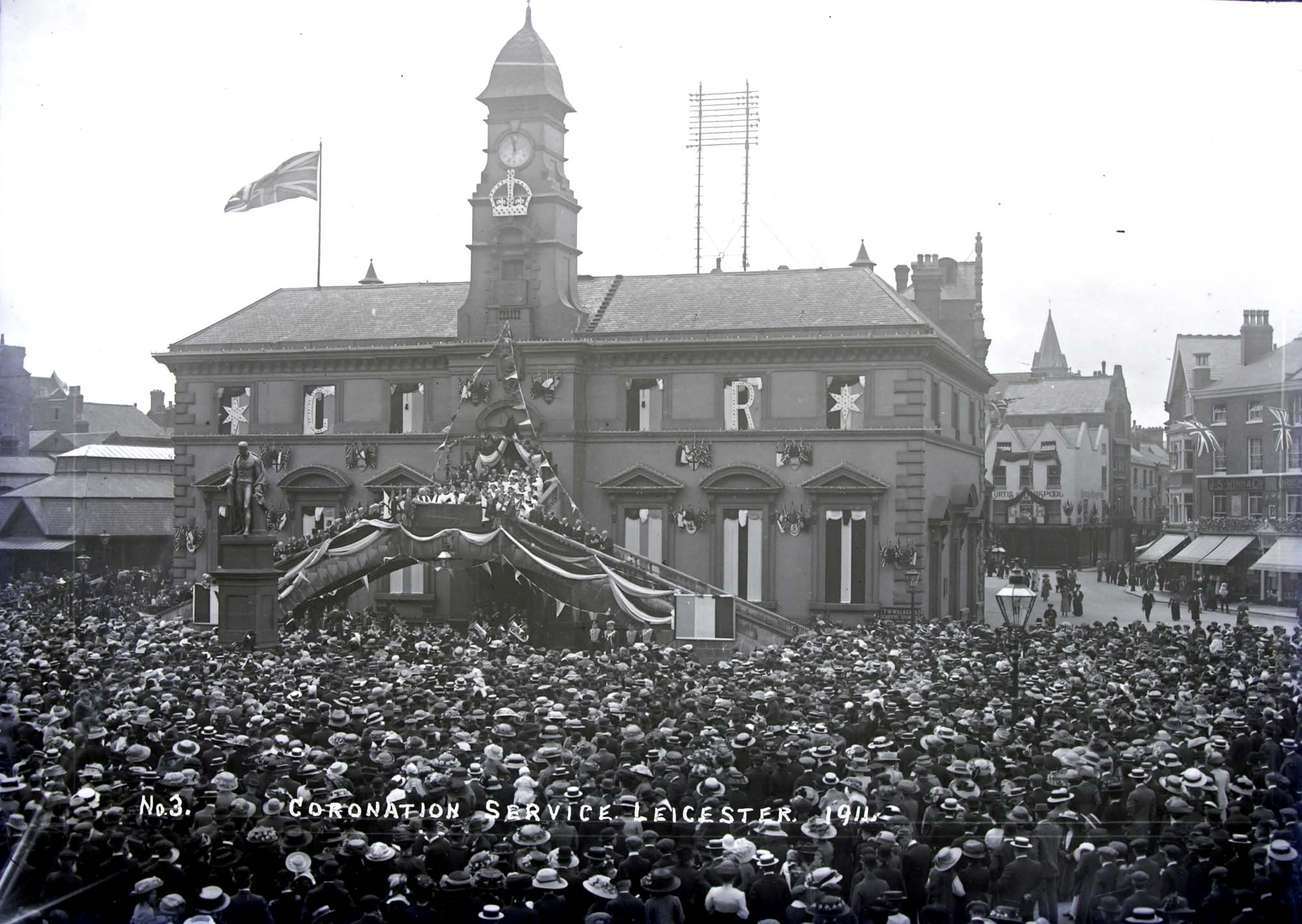 Huge crowds in Market Place celebrating the coronation of King George V and Queen Mary on 22 June 1911 - Leicestershire Record Office