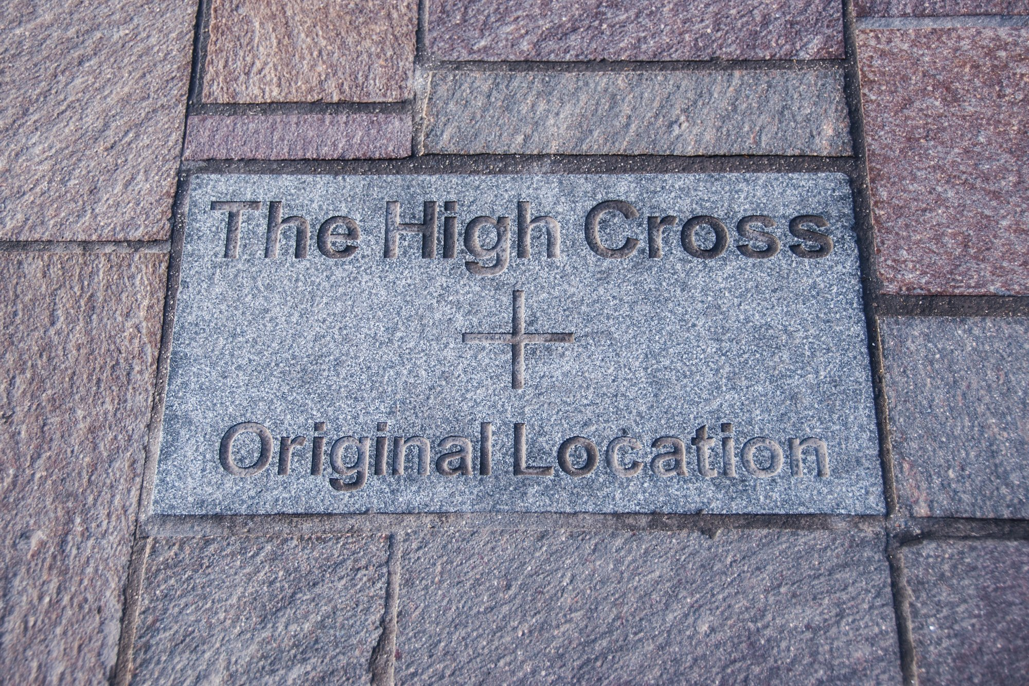 A stone in the road on Highcross Street marks the location of the original High Cross -