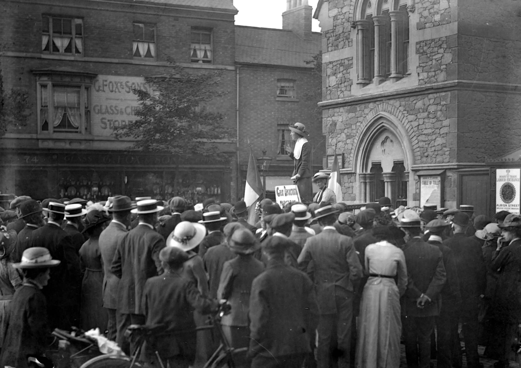 Suffragette meeting on Humberstone Gate next to the Weighbridge -