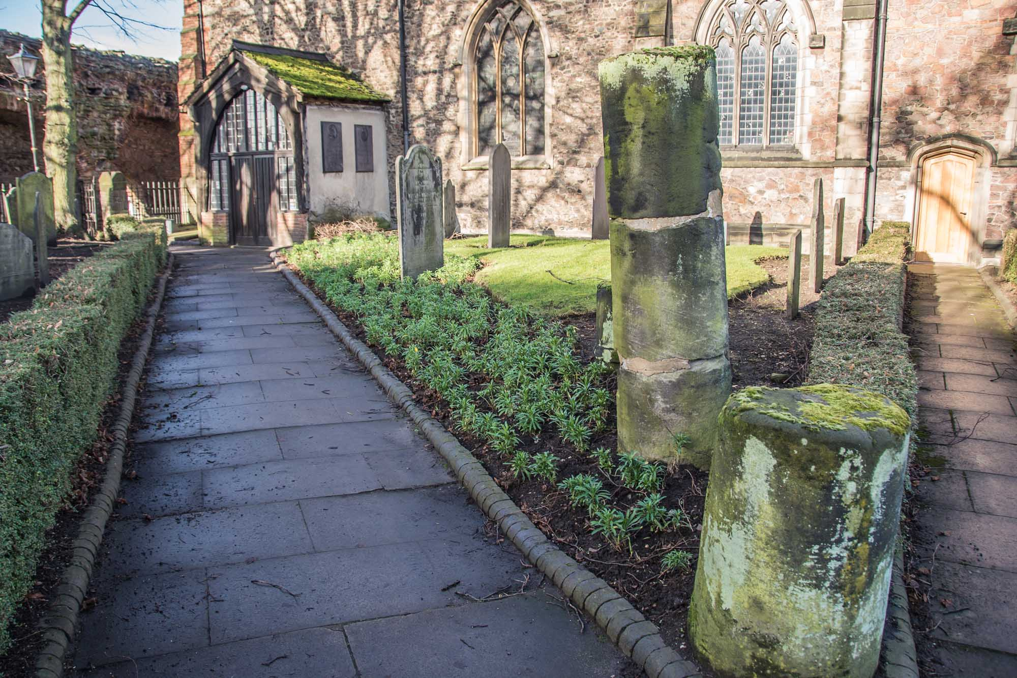 The stone pillars in the graveyard of St Nicholas Church believed to be from the Roman Forum -