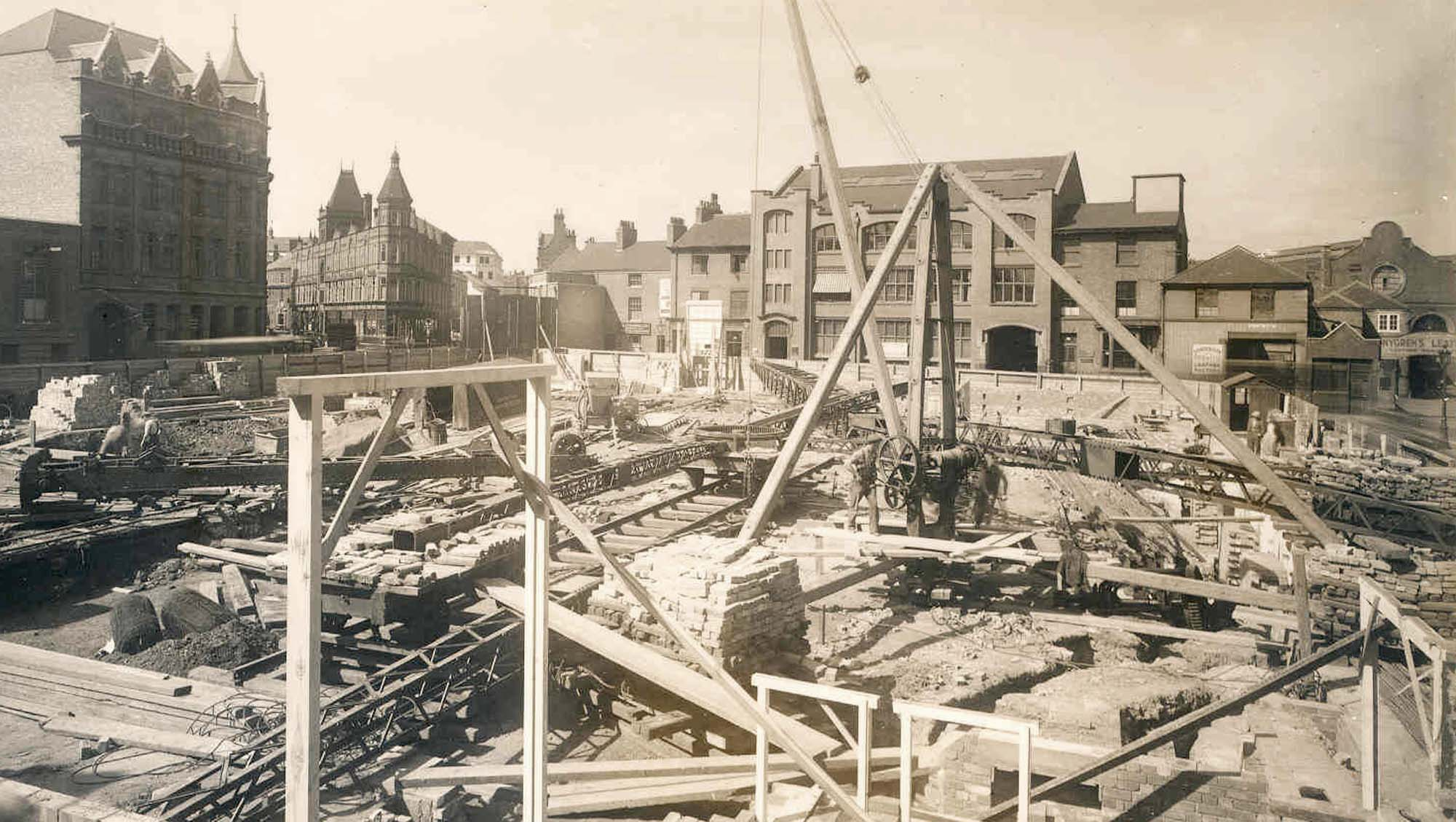 Looking across the Odeon Cinema construction site (1937) to the factory building that were replaced by the Curve -