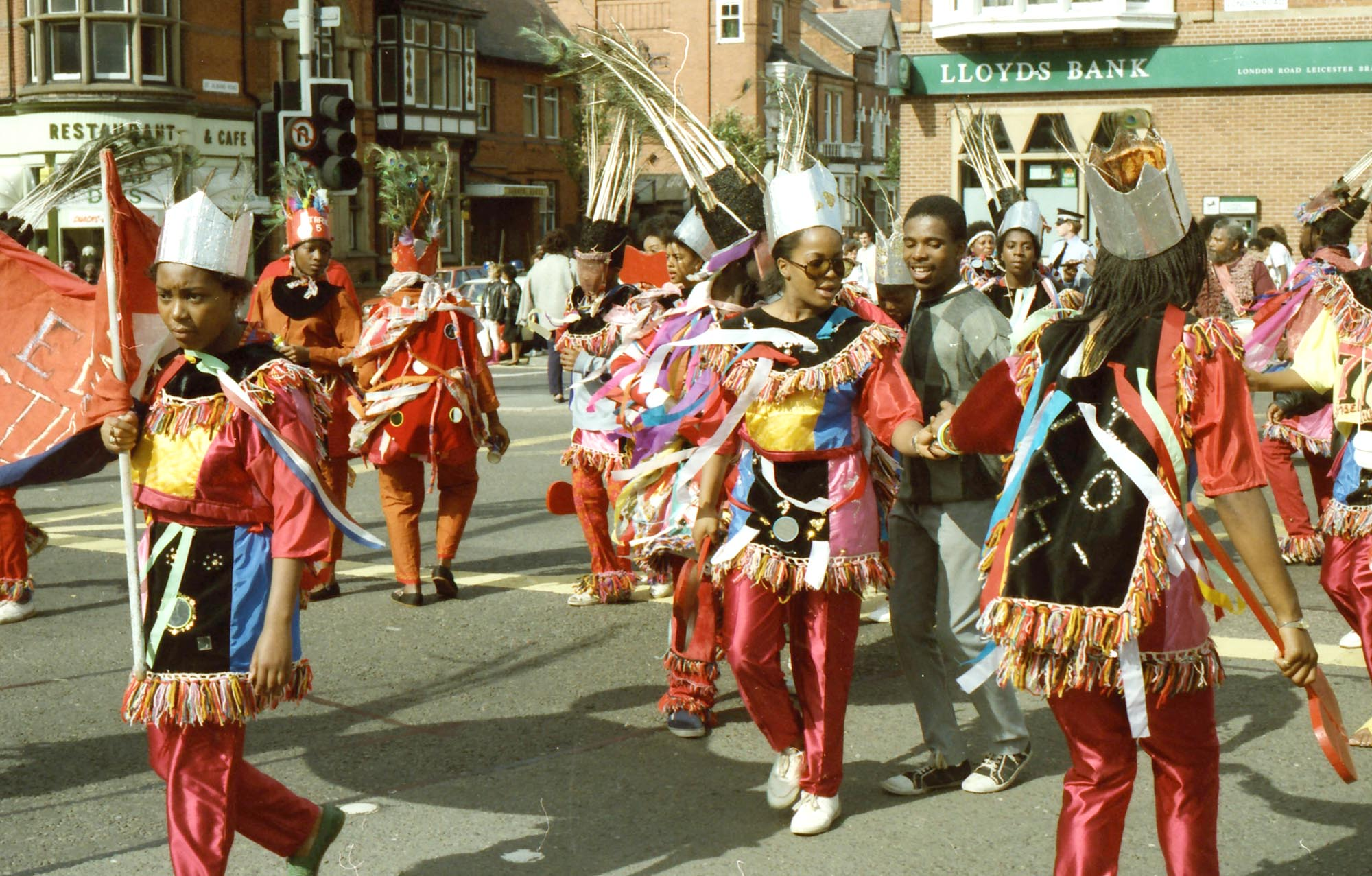 A dance troupe parading on London Road, 1986 -