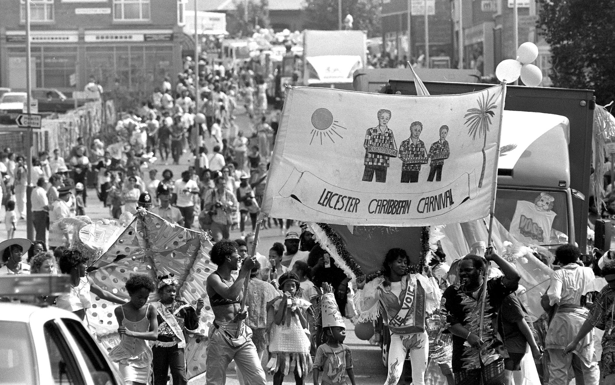 The Carnival parade makes its way along Sparkenhoe Street in front of large crowds, 1990 -