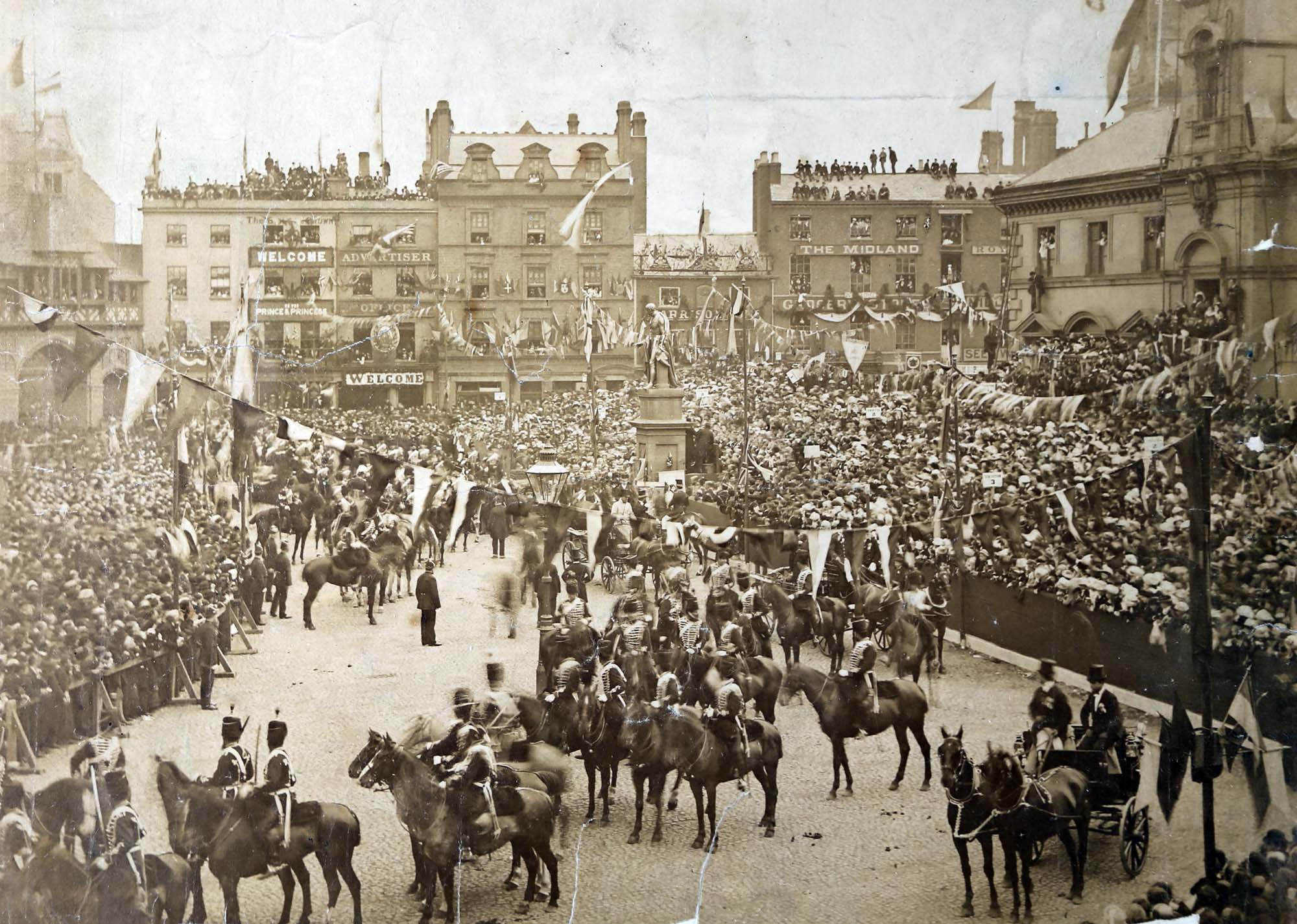 The Prince and Princess of Wales and  Princess of Wales passing by crowds in Leicester Market on the way to open Abbey Park, 1881 - Leicestershire Record Office
